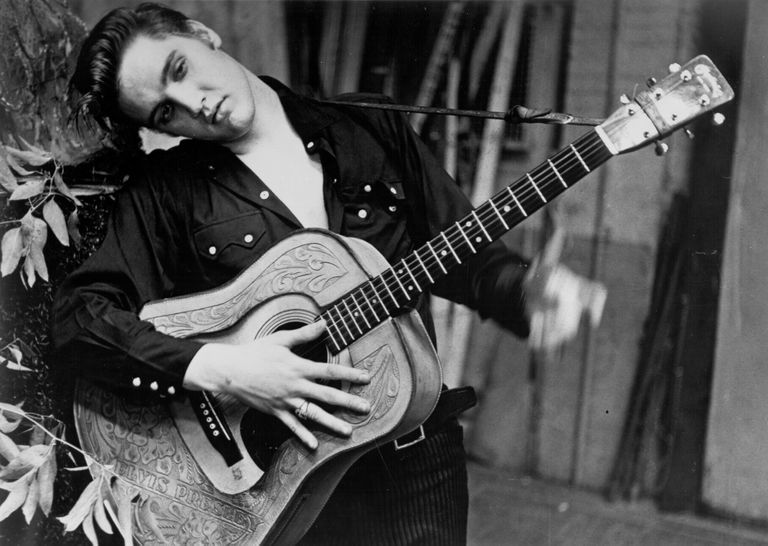 Elvis Presley with his guitar