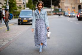 Street style woman in jean jacket and gingham maxi skirt