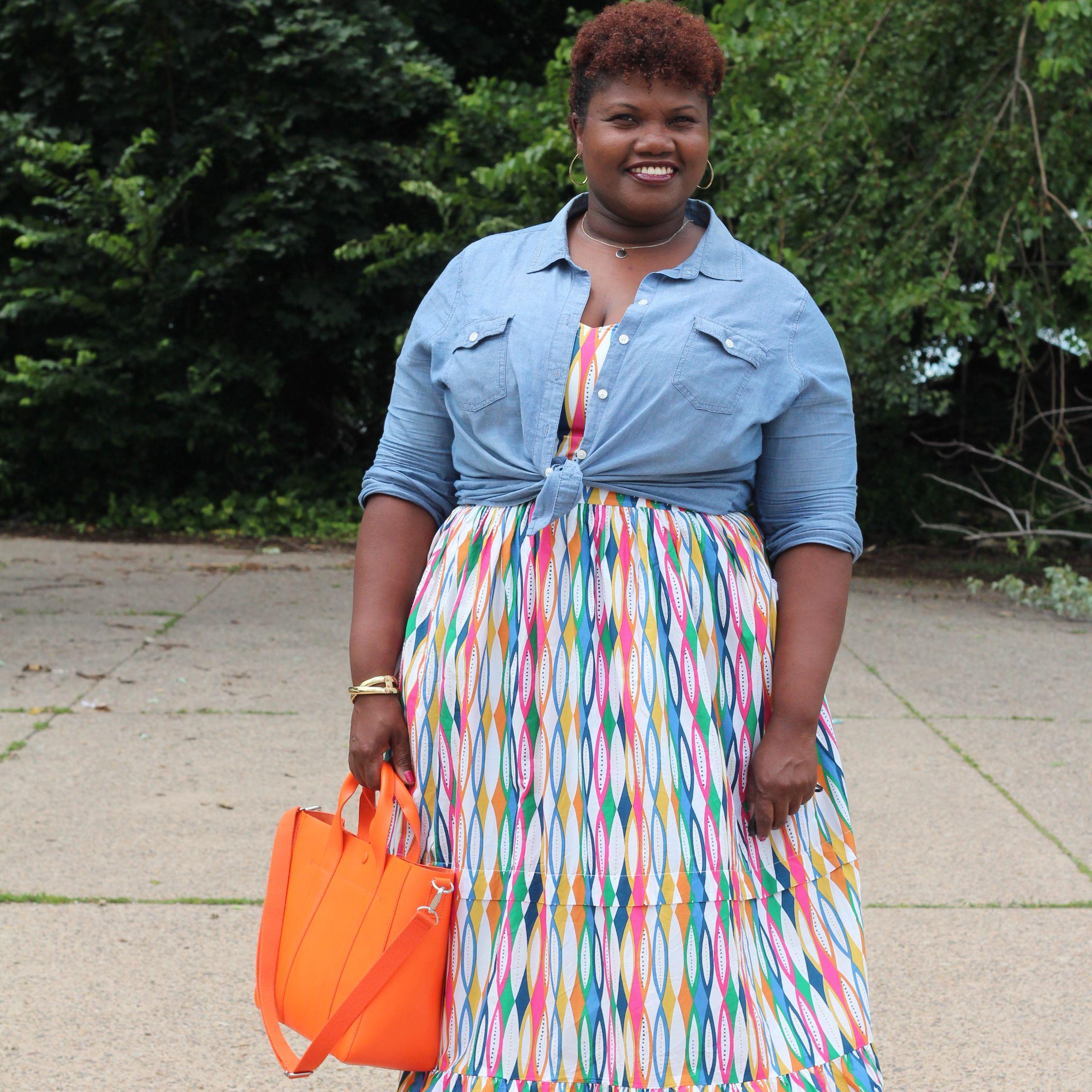 Woman in denim shirt and sundress