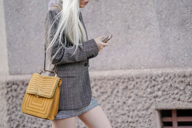 Street style woman in plaid blazer and yellow purse