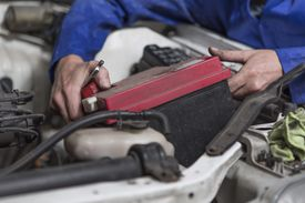 Man working on removing car battery