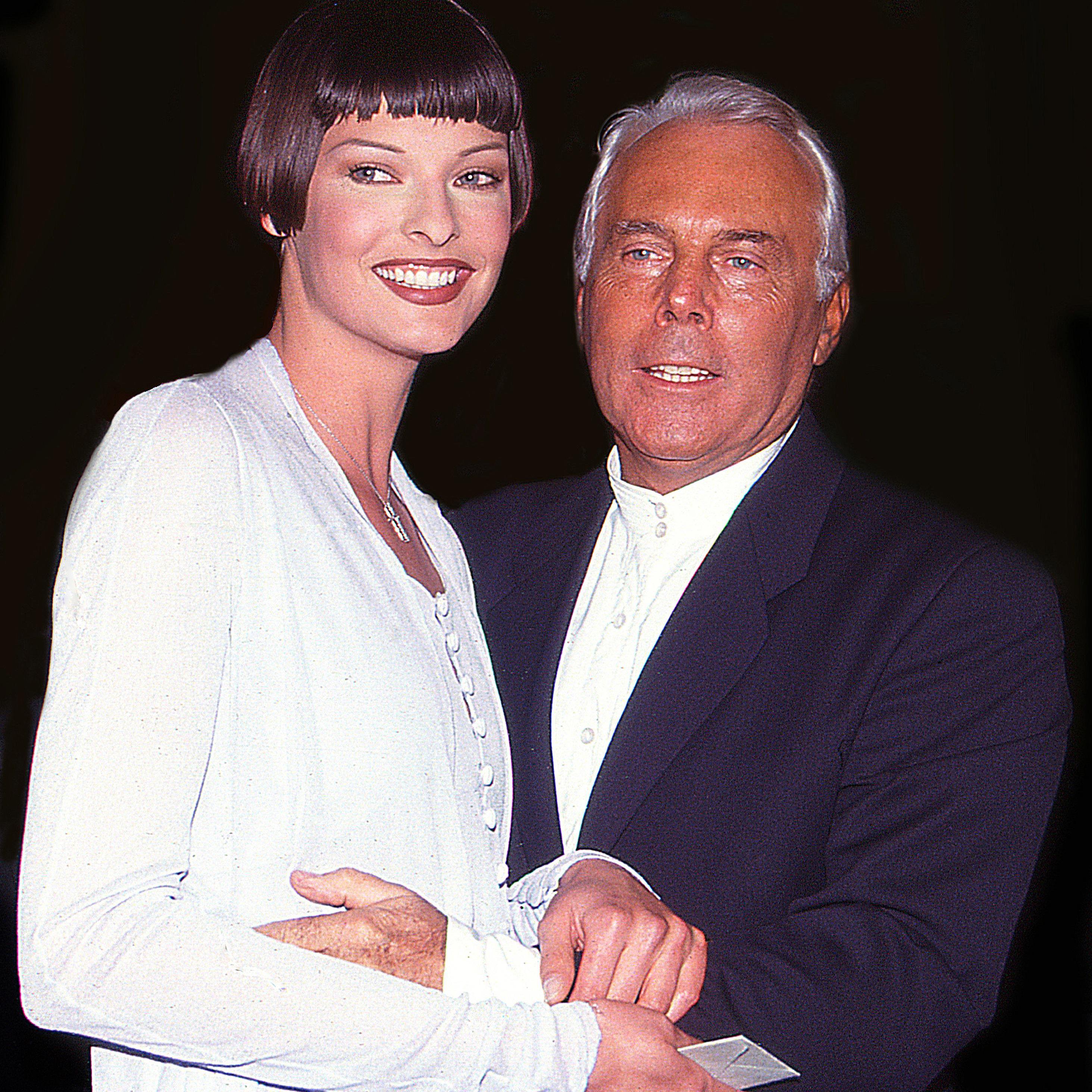 Linda Evangelista and Giorgio Armani at the Armani fashion party on West 57th street, New York, New York, 1997.