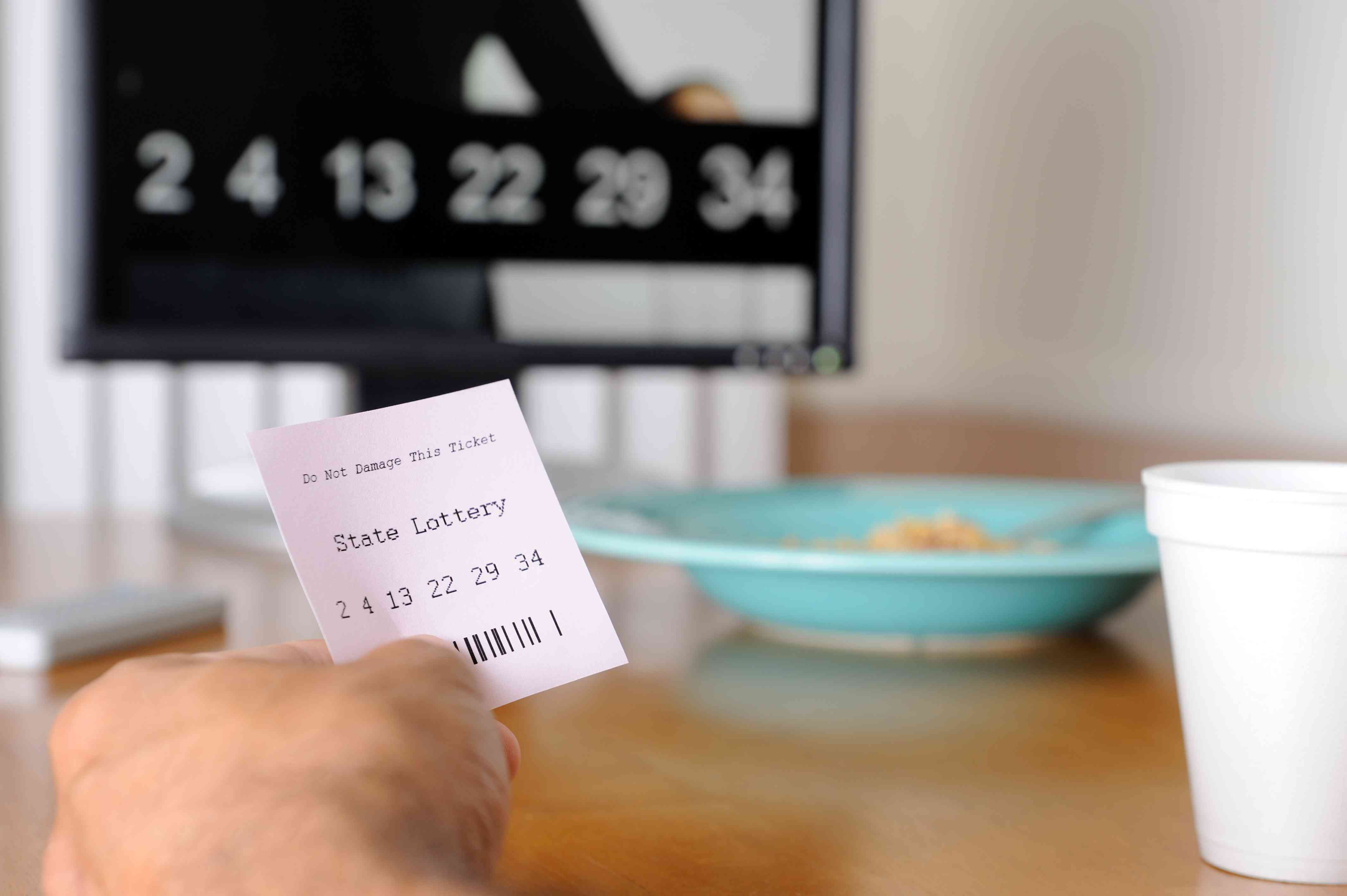 Image of a Person Checking a Lottery Ticket
