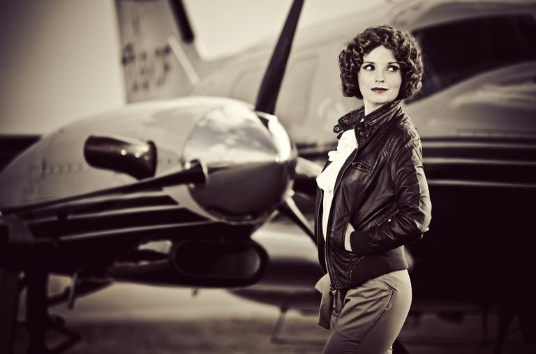 Vintage leather jacket on female pilot