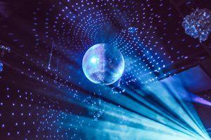 Low Angle View Of Illuminated Disco Ball At Night