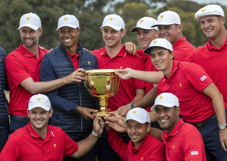 US team captain Tiger Woods and his teammates pose with the Presidents Cup after their win over the International Team at the 2019 Presidents Cup.