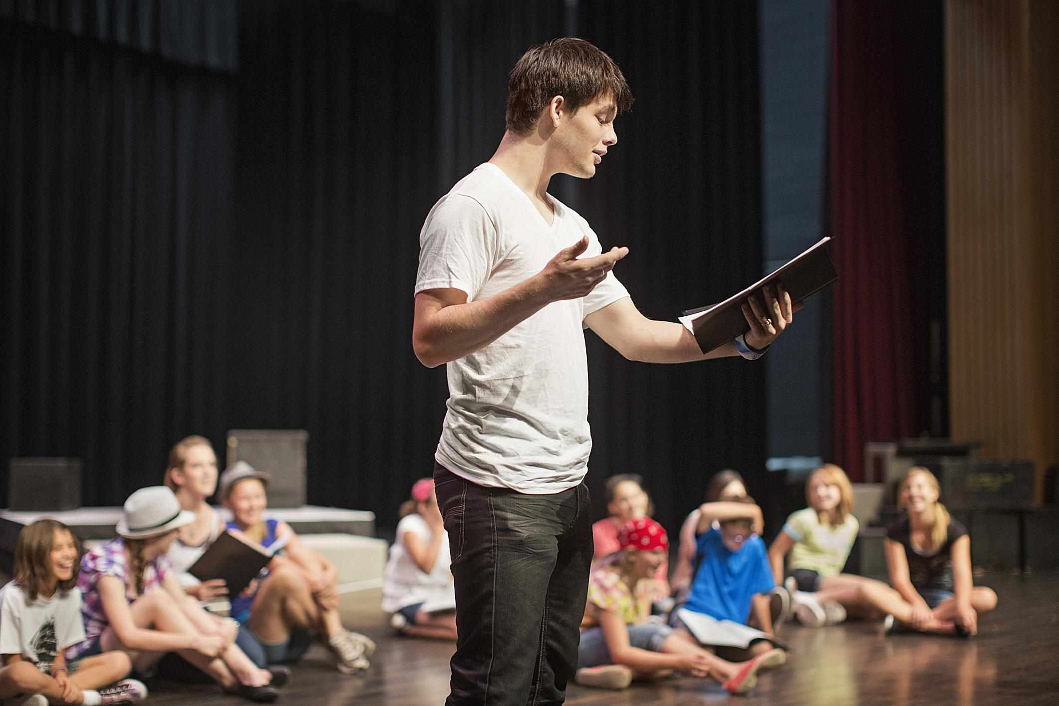 Young man on stage in an acting class