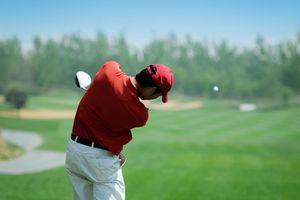 Golfer hits his drive