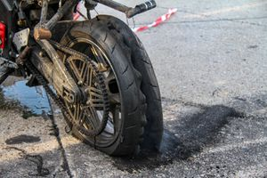 Damaged Tire of Motorcycle on Road