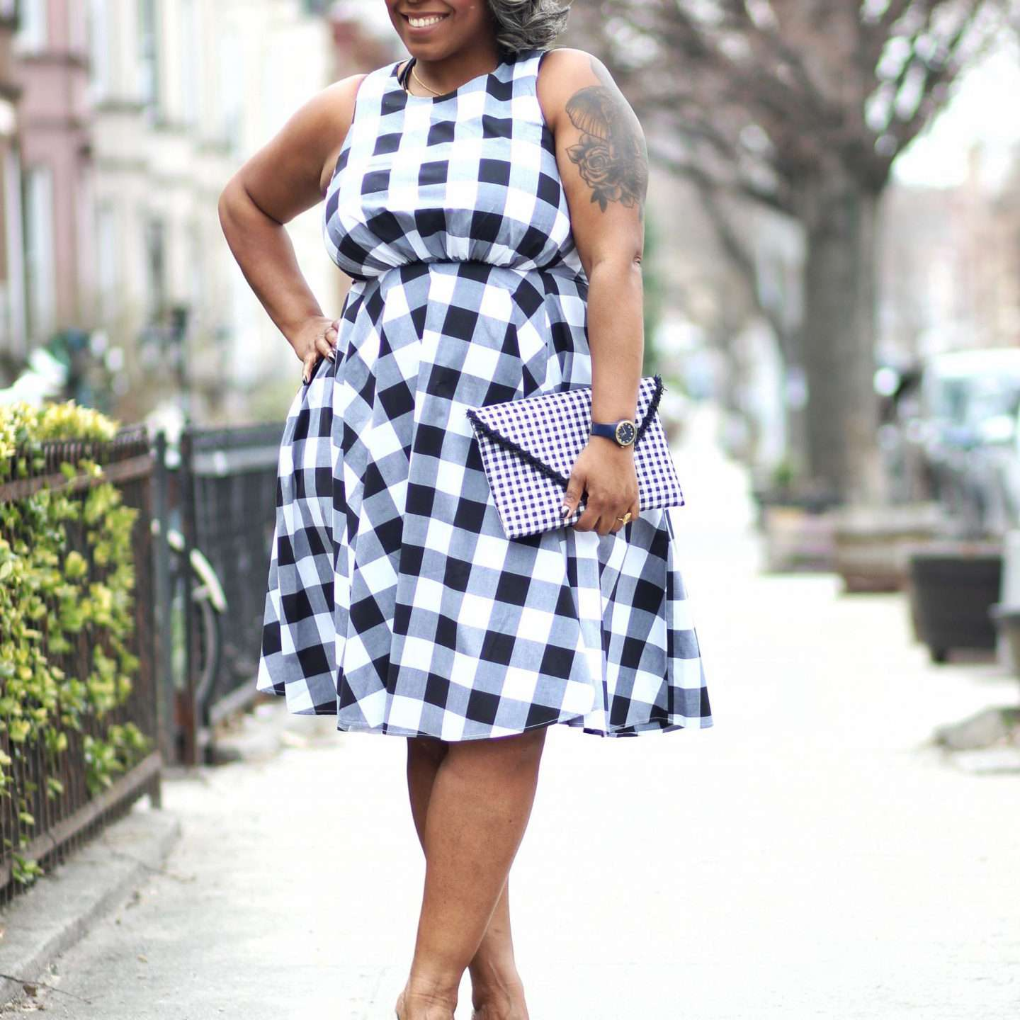 Woman in gingham summer dress