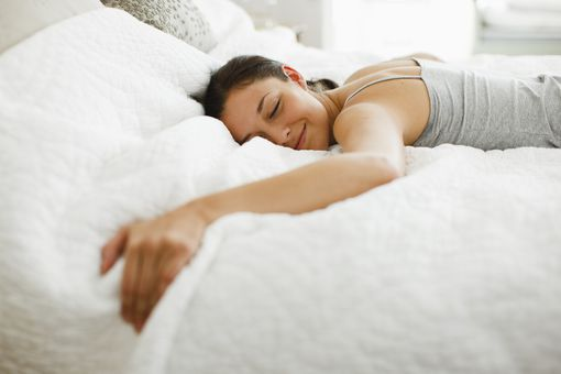 woman-smiling-on-bed.jpg