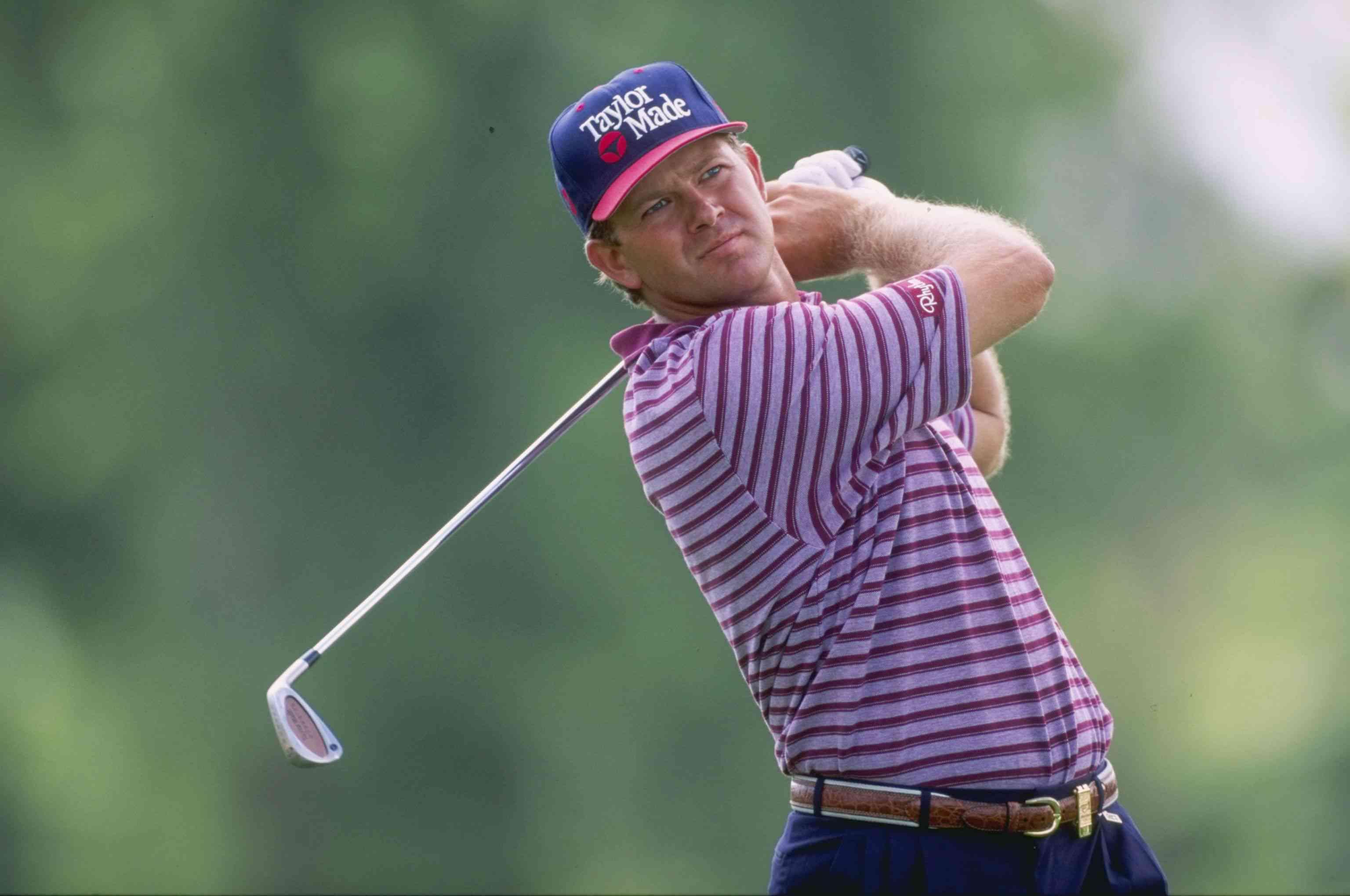 Golfer Retief Goosen plays the South African Open in 1997.