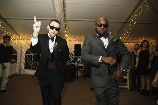 Groom and groomsmen dance at a wedding