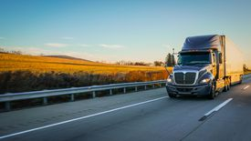 Semi truck 18 wheeler on highway copy space