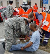German and U.S. medics work to identify and categorize role players during an emergency response exercise at U.S. Army Garrison Mannheim.
