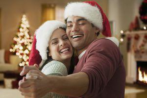 A man and woman dancing to Christmas music.