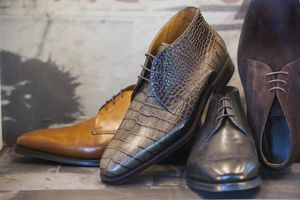 Men's brown leather pointy dress shoes on display