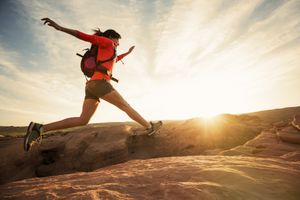 Image of a woman running outdoors from About.com's Sports and Outdoors Sweepstakes List.