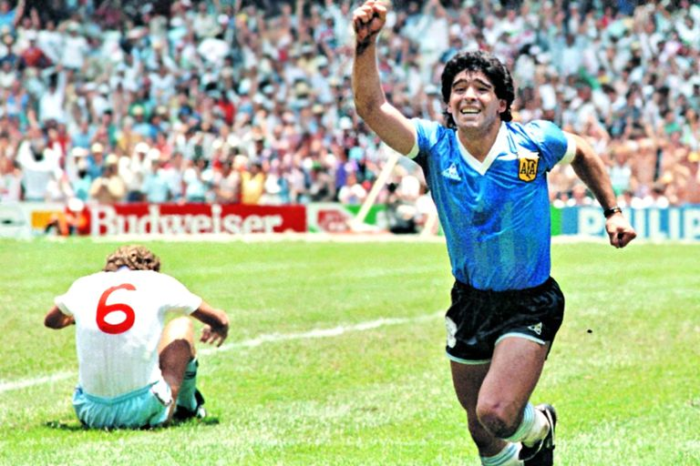 "Diego Maradona celebrating the ""Goal of the Century"" at the 1986 World Cup against England, with Terry Butcher seated on the field in dismay"
