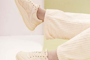 closeup of person wearing white sneakers