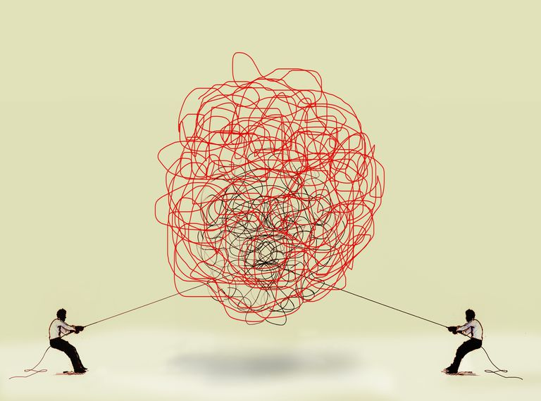 illustration of two people tugging at tangled ball of string