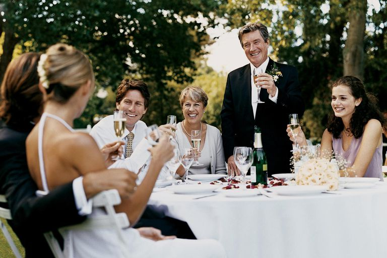 Father toasting the bride and groom at a garden wedding reception