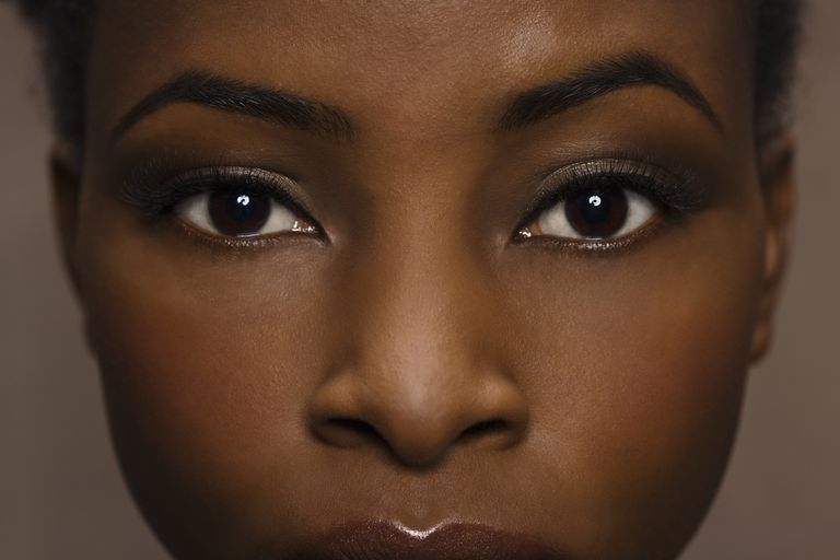 Close-up of woman's face with beautiful skin and long lashes