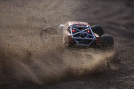 Off-road vehicle leaving a cloud of dust