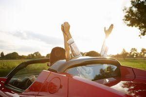 Couple in an electric sports car, fun