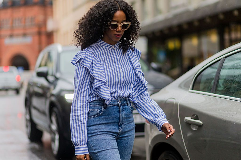 Ruffled blouse and jeans street style fashion