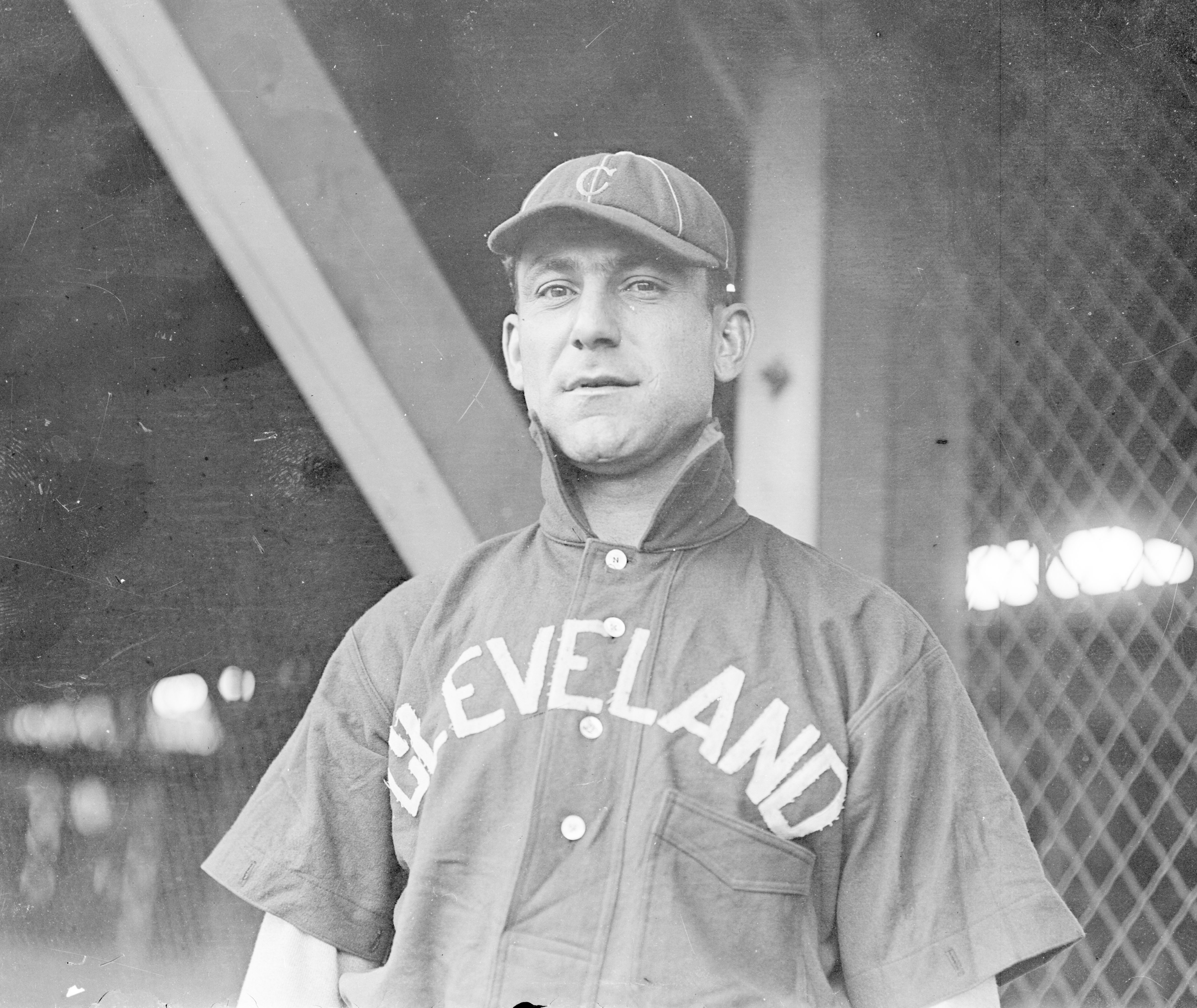 UNITED STATES - CIRCA 1903: Half-length portrait of baseball player, (Napoleon) Nap Lajoie, Hall of Fame second baseman for the Cleveland Naps, American League, standing in the dugout at South Side Park, Chicago, 1903. From the Chicago Daily News collection.