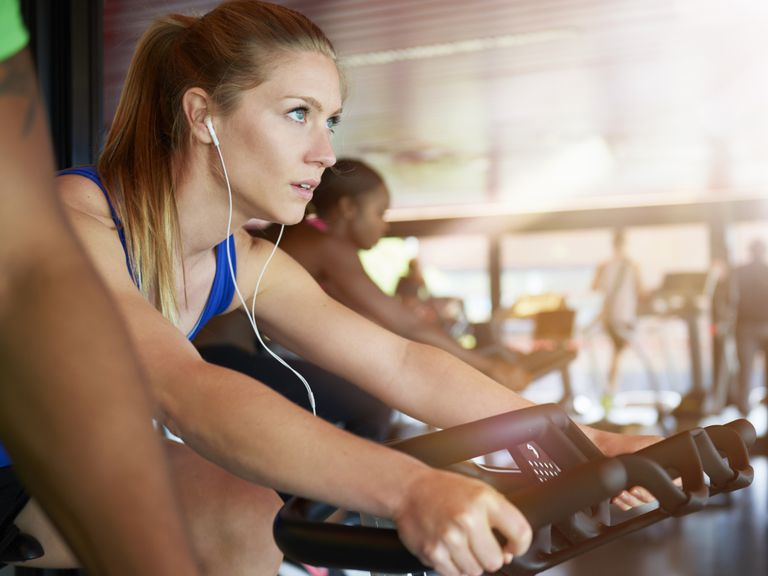 Woman on exercise bike in gym