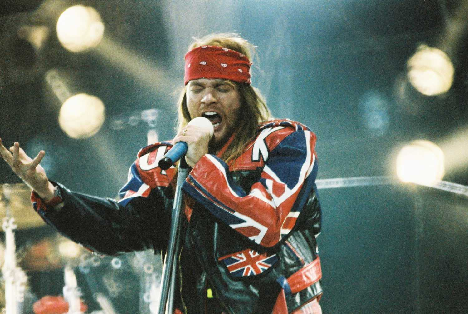 Axl Rose performing on stage.