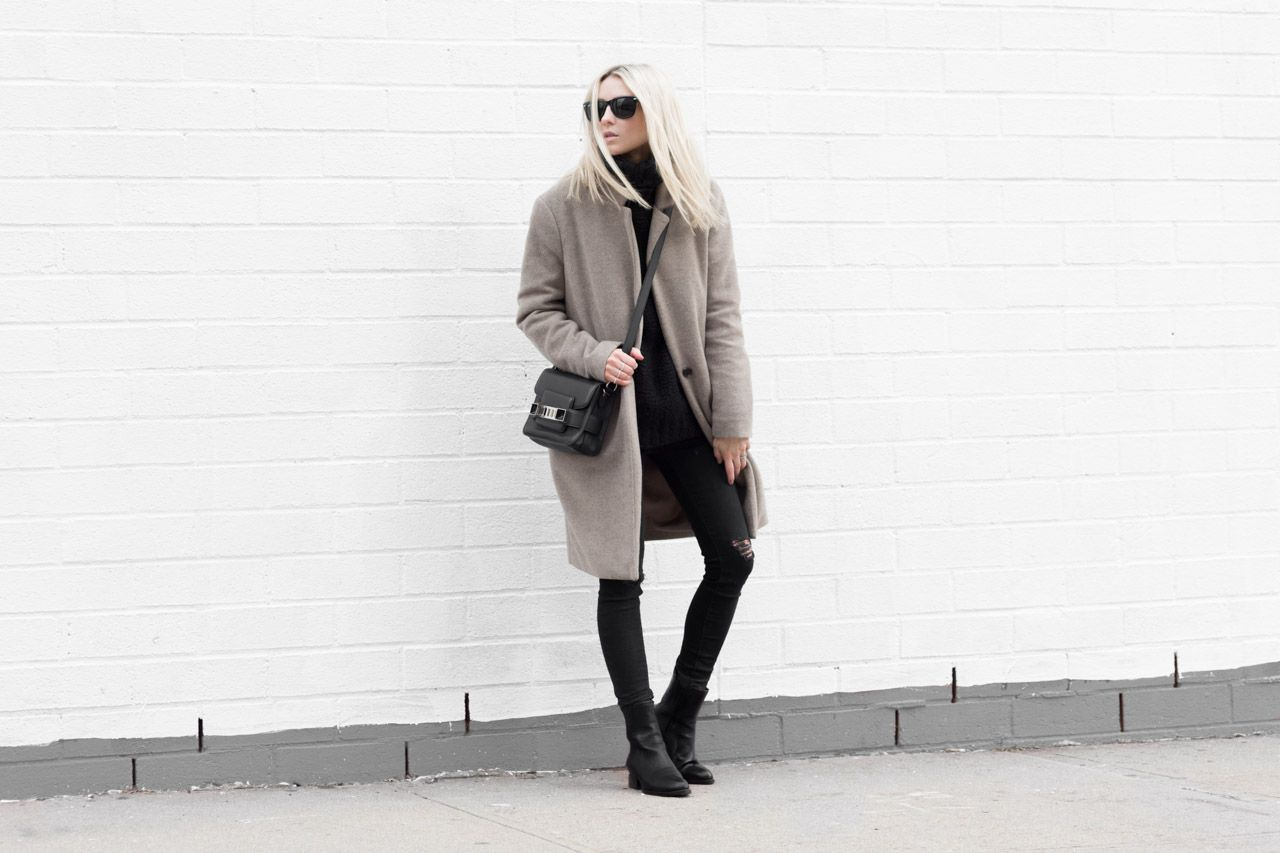 Street style fashion woman in camel fall coat and black outit
