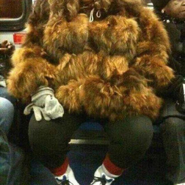 big fur coat on subway