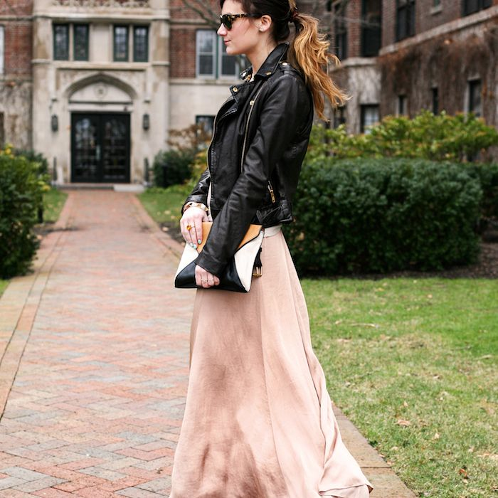 Woman Wearing a Gown With a Leather Moto Jacket