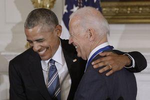 President Obama with his arm around VP Biden bth are smiling