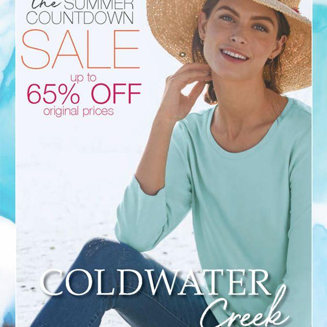 A woman wearing a beach hat and blue shirt