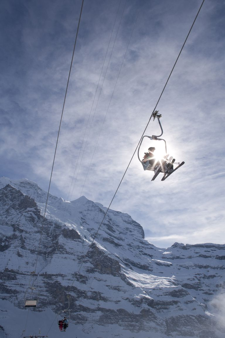 People on chairlift in Swiss Alps
