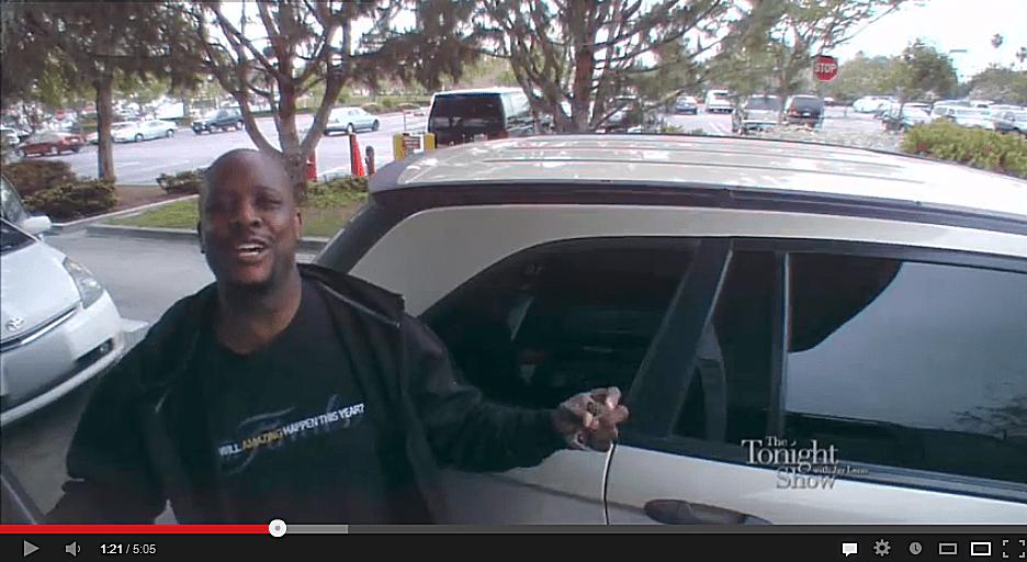 Man on camera by car caught in gas pump karaoke prank