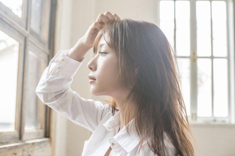 Woman inspecting hair