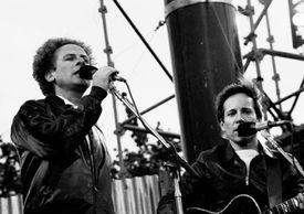 Singer-Songwriter duo Simon & Garfunkel performing outside at a concert in Dublin