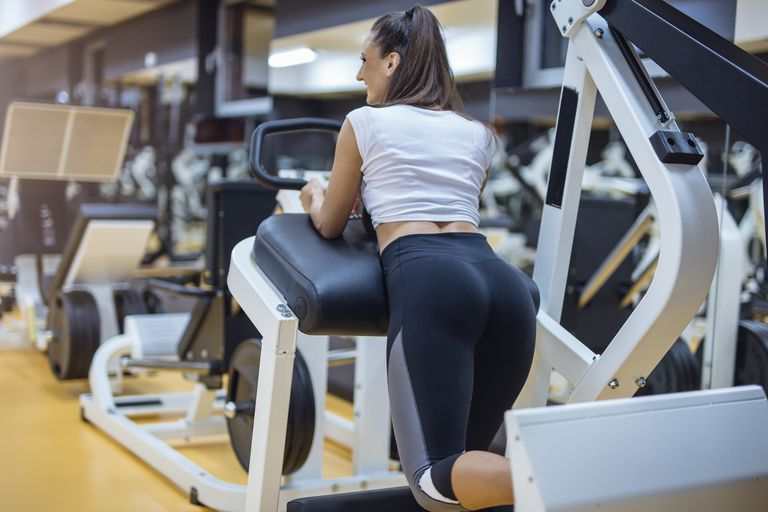 Leg work out on push press gym machine