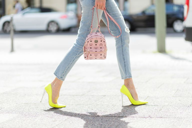 Street style fashion woman jeans and yellow shoes