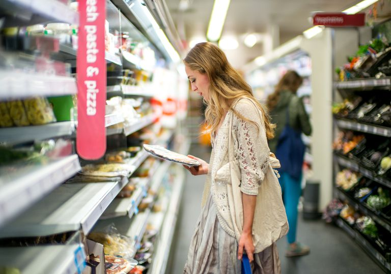 Woman buying food at grocery store