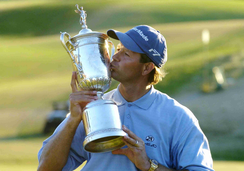 Retief Goosen kisses the U.S. Open trophy after winning the tournament in 2004.