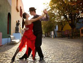 Young couple dancing Tango in street