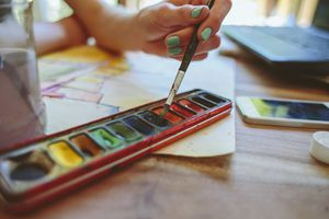 An artist painting with watercolors