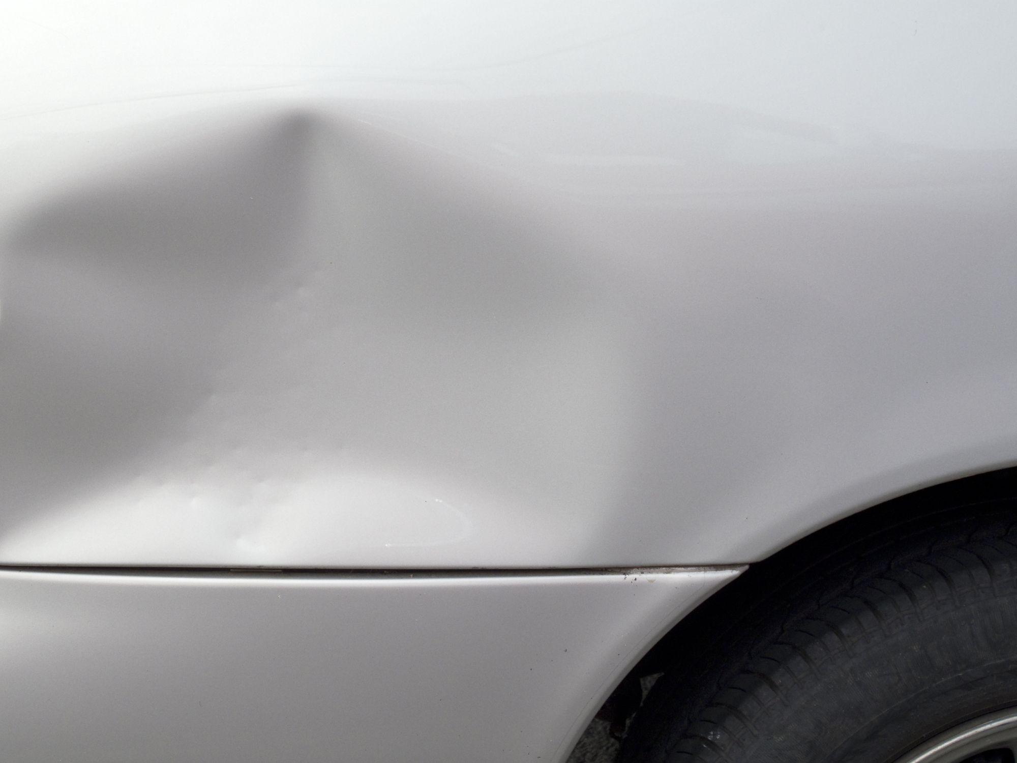 image of dented rear fender