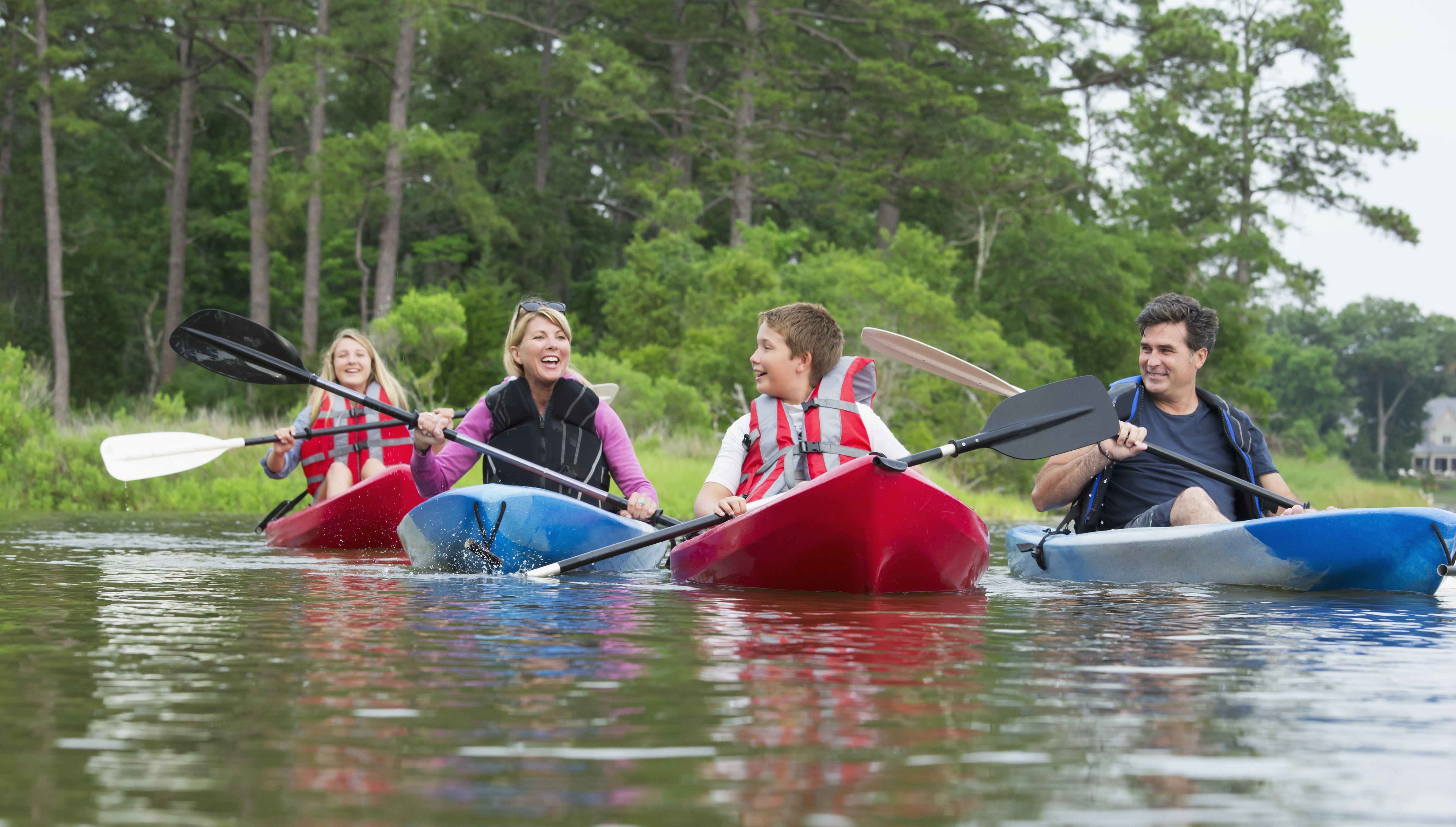 family recreational kayaking in river